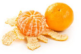 A tangerine and mandarin peeled — Stock Photo