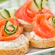 Sandwiches with salmon and cucumber - Stock Photo