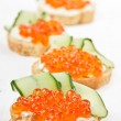 Sandwiches with red caviar and cream cheese - 