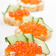 Sandwiches with red caviar and cream cheese - Stock Photo