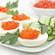 Eggs stuffed with caviar - Stock Photo