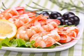 Royal shrimps on wooden skewers — Stock Photo