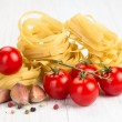 Stock Photo: Nest egg noodles with tomatoes and garlic
