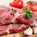 Raw beef steak — Stock Photo