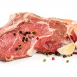 Raw beef with garlicon white background — Stock Photo