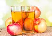 Apple juice on a wooden surface — Stock Photo