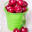 Two buckets with a cherry — Stock Photo #27311931