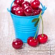 Two buckets with a cherry — Stock Photo #27311953