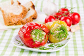 Stuffed red and green peppers — Stock Photo