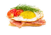 Sandwich with a fried egg and bacon — Stock Photo