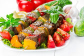 Grilled meat on skewers with vegetables — Stock Photo
