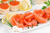 Sliced salmon and canape withcaviar — Stock Photo