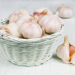 Stock Photo: Garlic in wicker basket