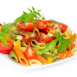 Colorful pasta on a white plate — Stock Photo #34648937