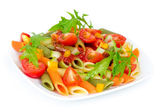 Colorful pasta on a white plate — Stock Photo
