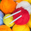 Balls of wool yarn and knitting needles — Stock Photo