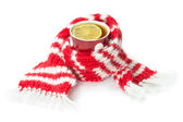 Wool scarf, wrapped around a cup of tea — Stock Photo