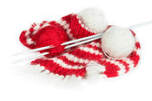 Red woolen scarf, knitting needles and balls of yarn — Stock Photo