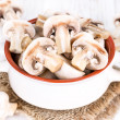Mushrooms in a ceramic bowl — Stock Photo #35592407
