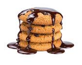 Oatmeal cookies, watered liquid chocolate — Stock Photo