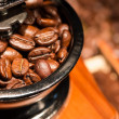 Stock Photo: Coffee beans in a mill.