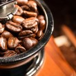 Coffee beans in a coffee- mill. — Stock Photo