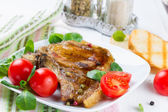 Grilled meat with tomato — Stock Photo
