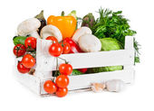 Fresh vegetables in wooden box — Stock Photo