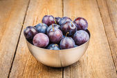 Ripe Plums in Silver Metallic Bowl — Stock Photo