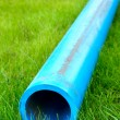 Royalty-Free Stock Photo: Harmless polyethylene water pipes on a green grass