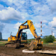 Stock Photo: Excavator against the dark blue sky