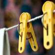 Photo of linen clothespins close up - Stock Photo