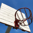 Street basketball basket against the blue sky — Stock Photo
