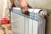 Real photo of installation of a radiator — Stock Photo