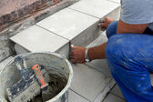 Real photo of a tile laying — Stock Photo