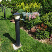 Garden lamp on a green grass — Stock Photo
