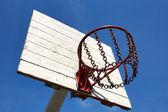 Street basketball basket against the blue sky — Stock Photo