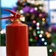 Royalty-Free Stock Photo: Fire extinguisher and New Year tree