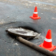 Repair of a sewer well on the asphalted road — Stock Photo