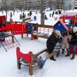 Stock Photo: Children play in playground in winter