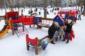Children play in the playground in winter — Stock Photo
