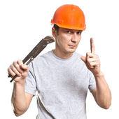 The working plumber with the tool — Stock Photo
