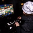 Player at the slot machine - Stock Photo