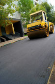 Road repair, compactor lays asphalt. — Stock Photo