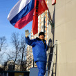 Russian flag hanging on building — Stock Photo #22259613