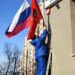 Stock Photo: Russian flag hanging on building