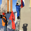 Russian flag hanging on building — Stock Photo #22259751