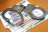 Handcuffs and rubles — Stock Photo