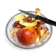 Apple and a knife on a crystal plate — Stock Photo #22711989