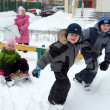 Children sledding in winter — Stok fotoğraf
